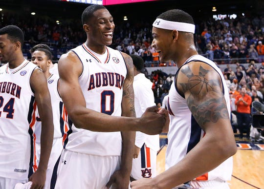 Auburn forward Horace Spencer, left, and guard Bryce Brown, right, celebrate after the team's 88-77 win against Arkansas in an NCAA college basketball game, Saturday, Jan. 6, 2018, in Auburn, Ala.