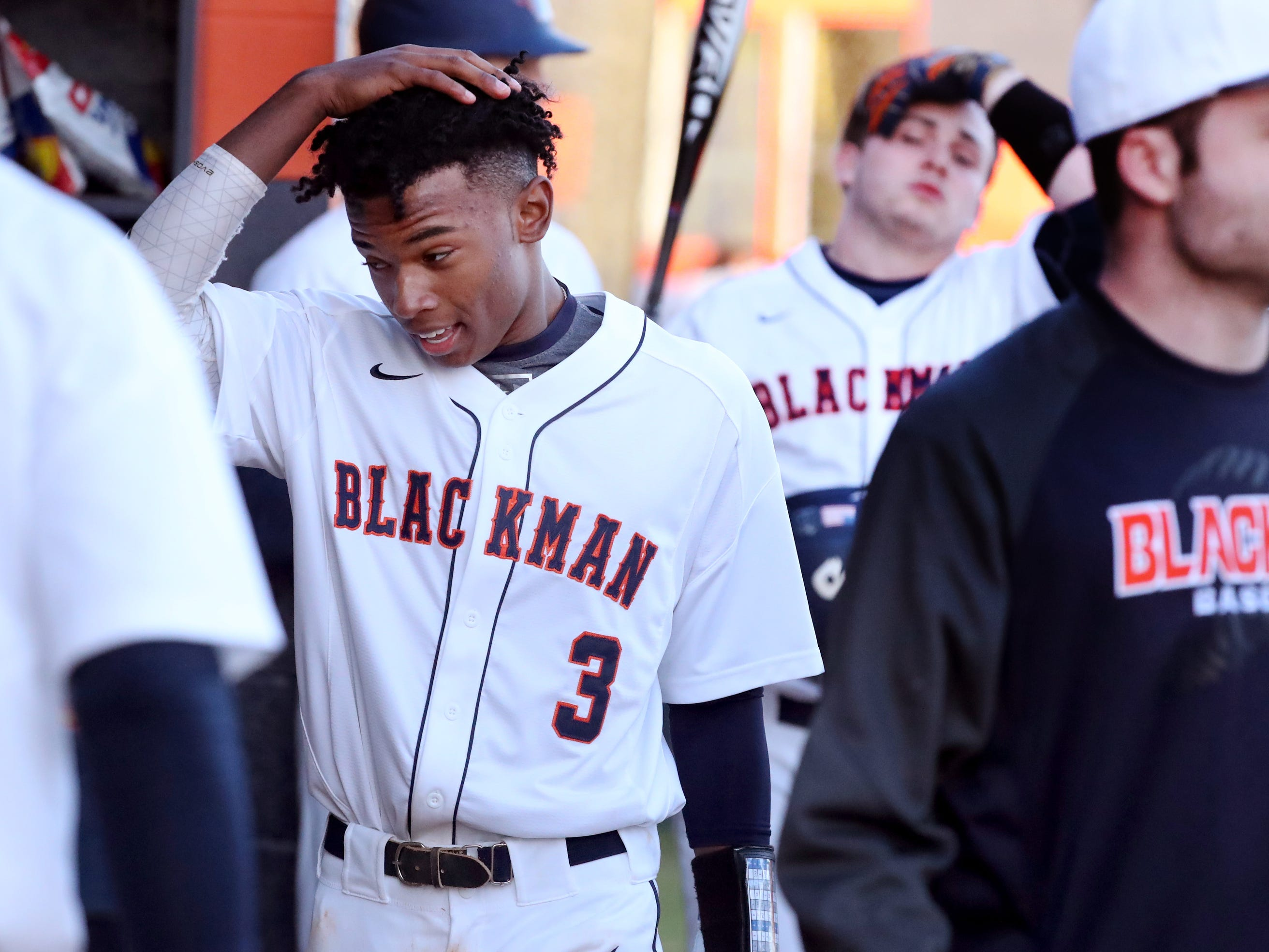 Blackman's Simaree Lewis (3) comes into the dugout after scoring a run against Siegel on Monday, March 11, 2019.