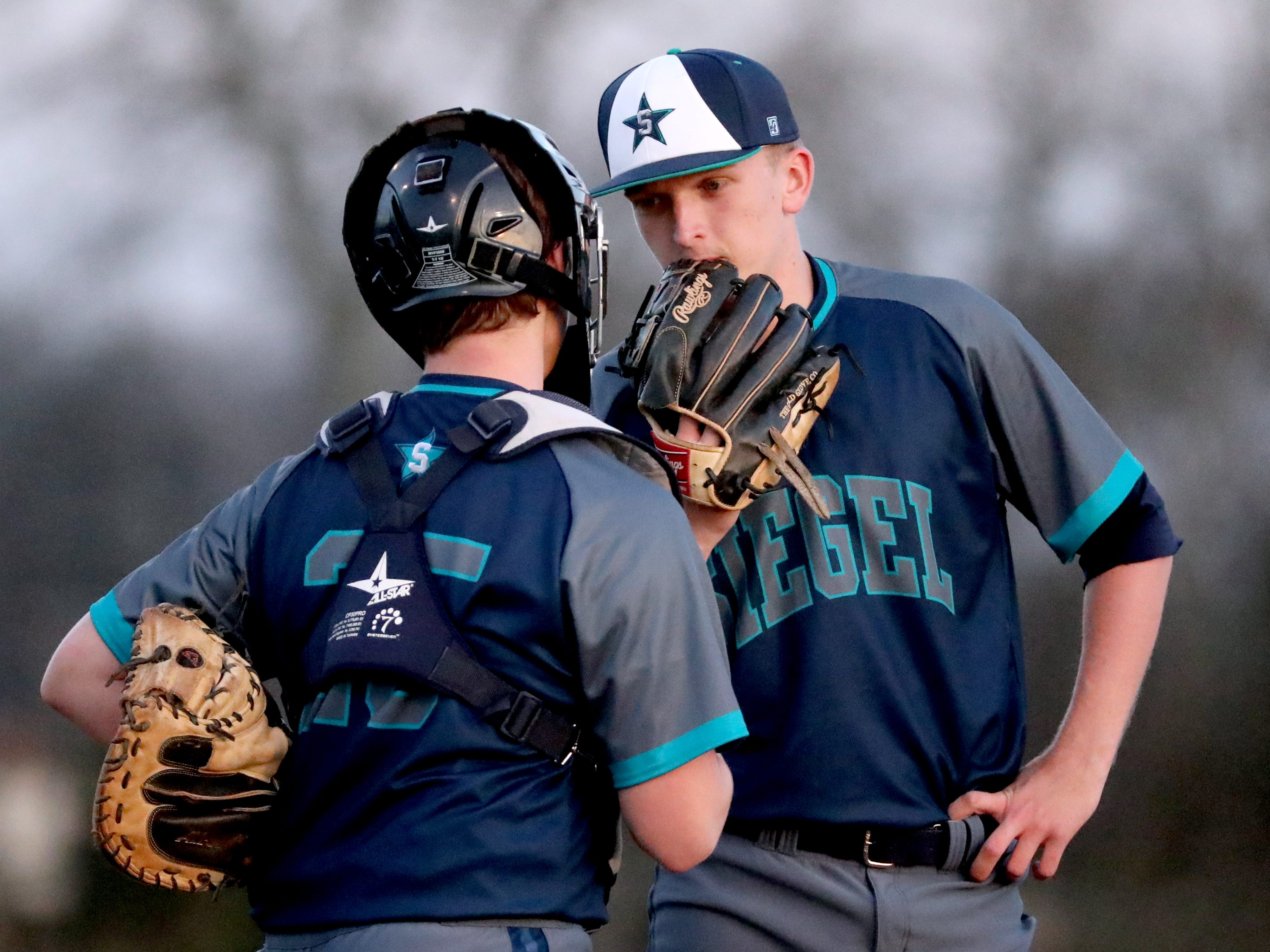 Siegel's catcher Jackson Cauthron (25) and Siegel's pitcher Jaden Lasley (17) talk on the pitchers mound during the game against Blackman, on Monday, March 11, 2019.