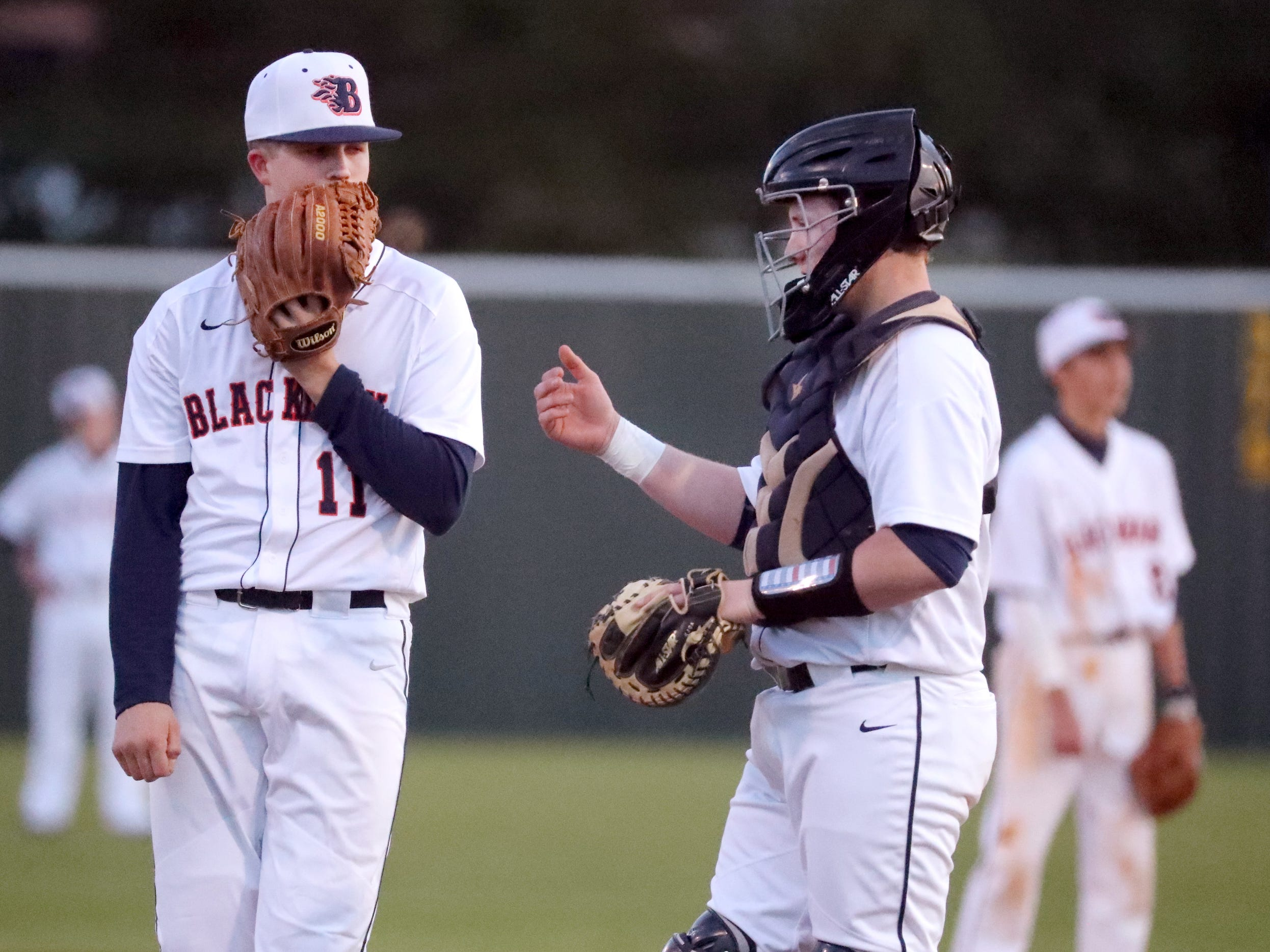 Blackman's pitcher Drew Beam (11) and Blackman's catcher David Milam (10) on the pitcher's mound during the game against Siegel, on Monday, March 11, 2019.