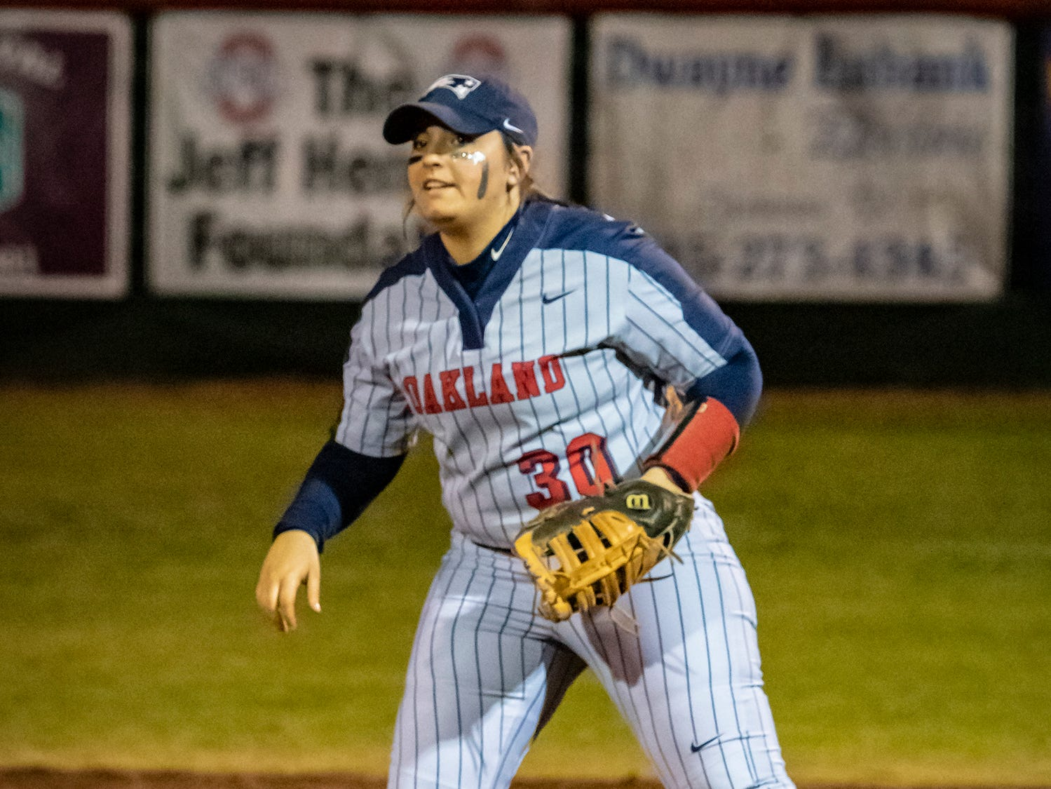 Oakland first baseman Haileigh Ellinger eyes home plate during Monday's game against Stewarts Creek.
