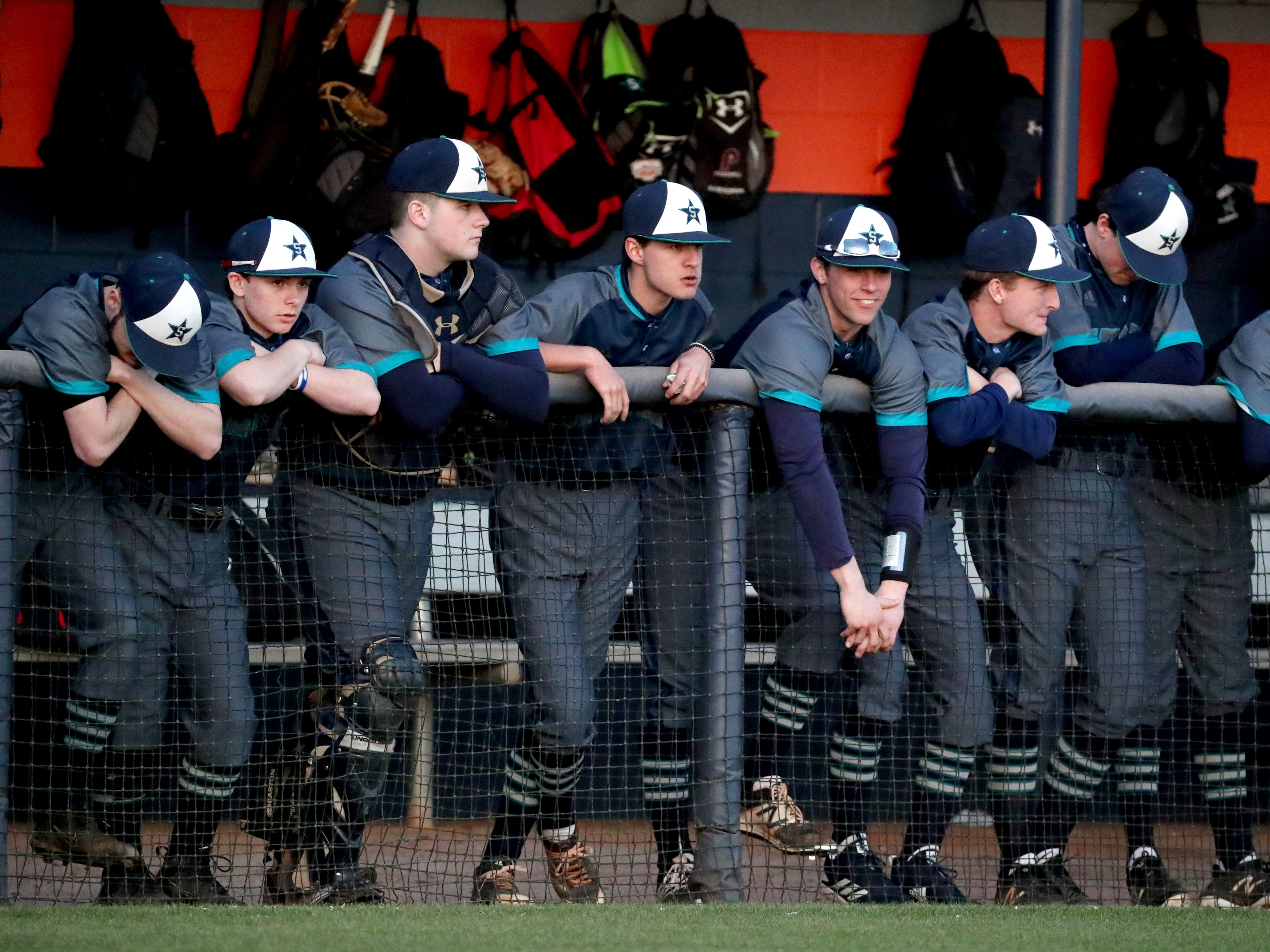 Siegel players watch the game against Blackman from the dugout on Monday, March 11, 2019.