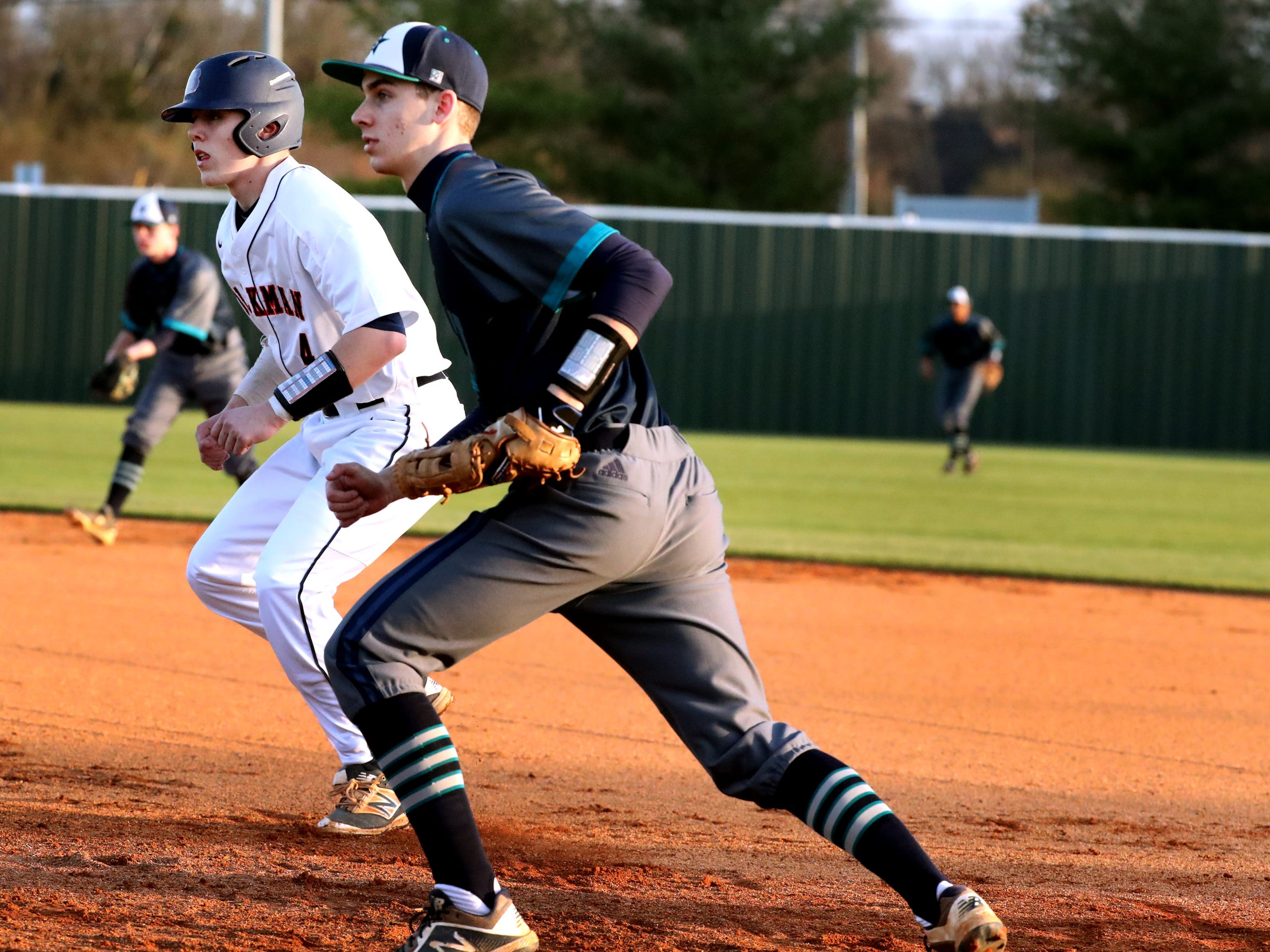 Siegel's Dylan Taylor (26) steps off first base as Blackman's Blaze Bell (4) takes a lead off the base on Monday, March 11, 2019.