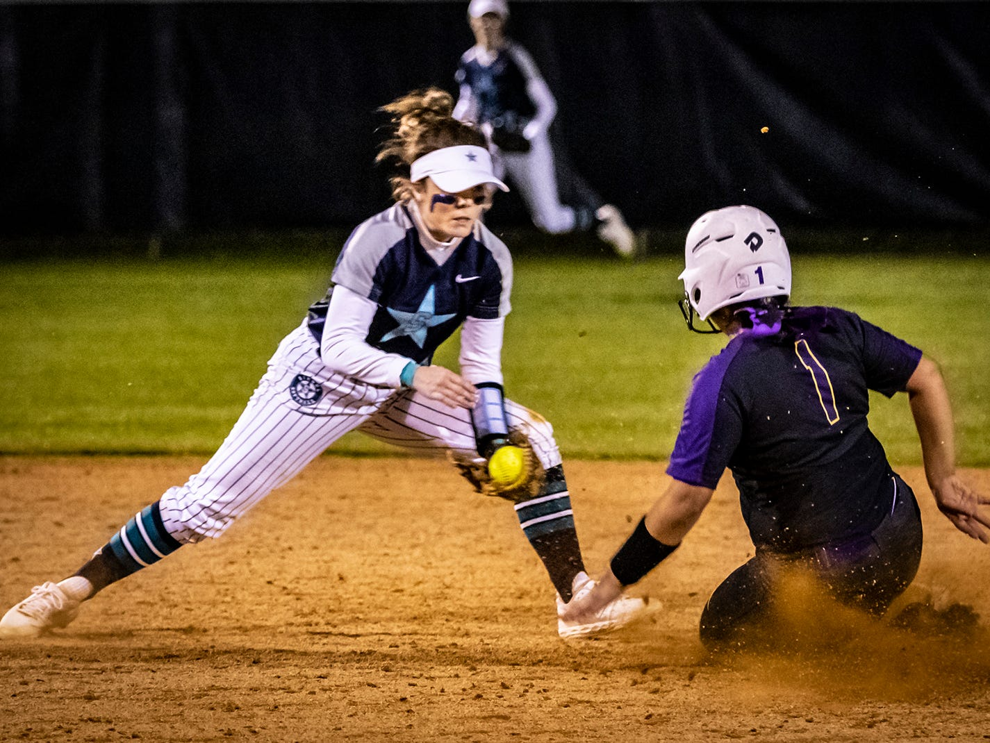 Siegel shortstop Vanessa Westfall tags out Smyrna's Ashlynn Dimmick trying to advance to second.