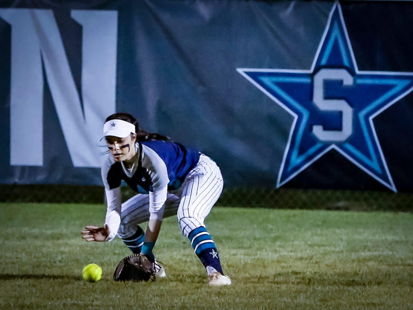 Siegel's Lauren Lee fields a hit during Monday's win over Smyrna.