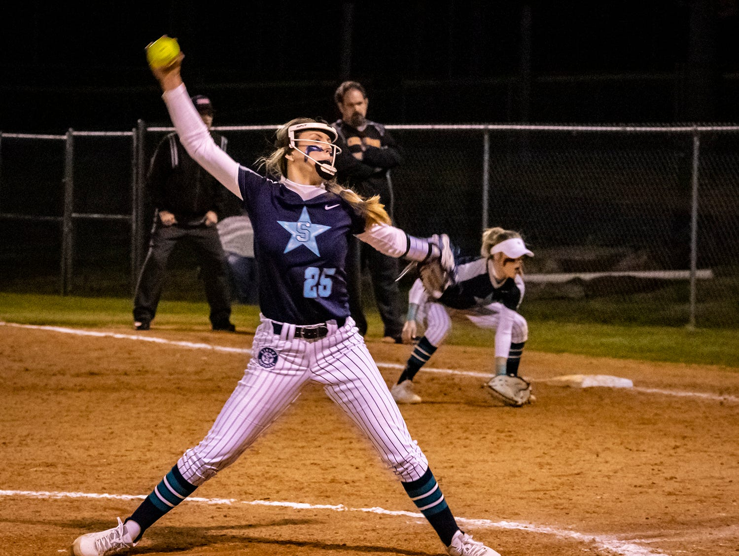 Siegel pitcher Sophie Golliver first a pitch during her shutout performance against Smyrna Monday.