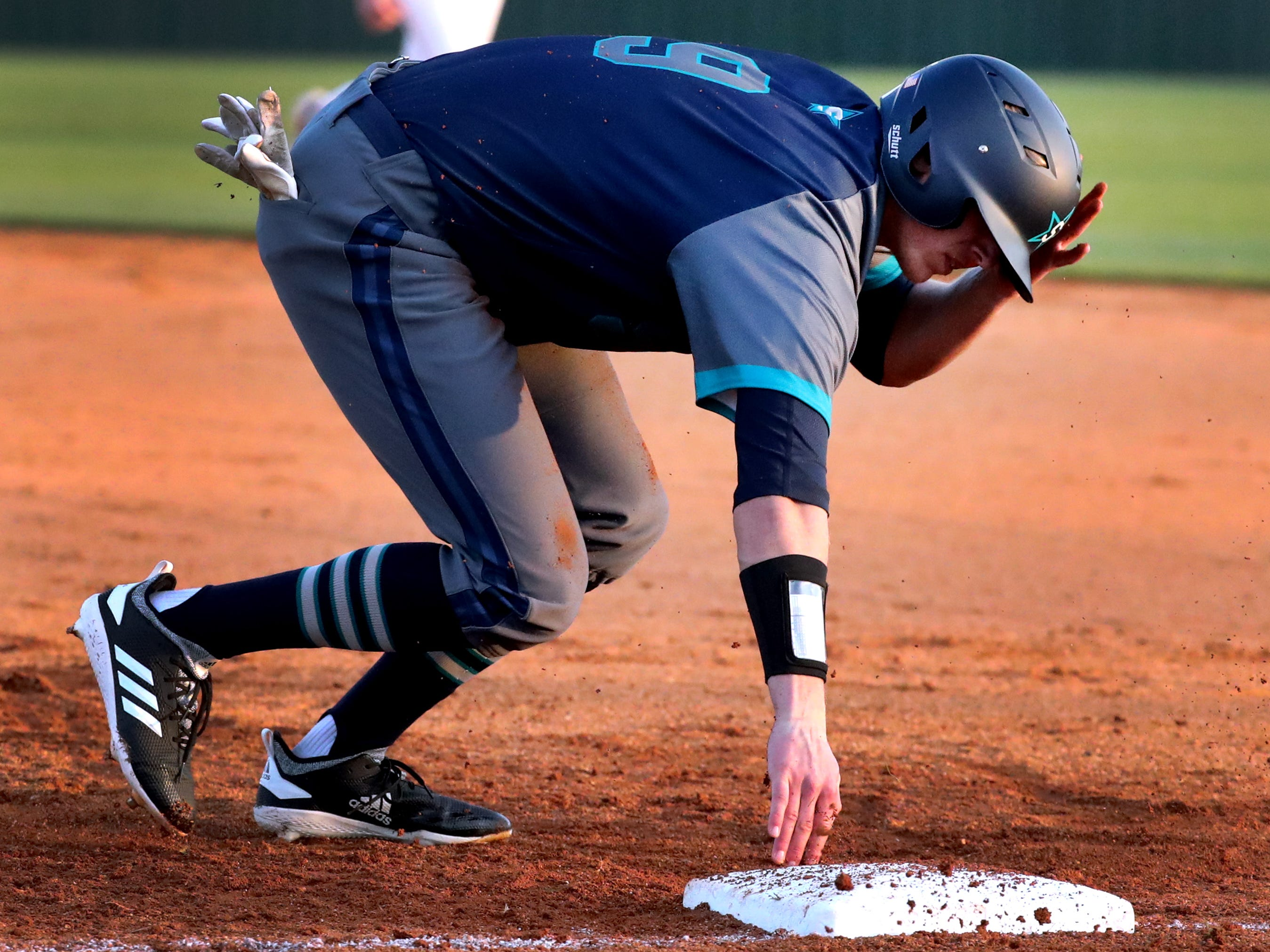 Siegel's Evan Milligan (9) gets up from first base to run toward second base after the ball was overthrown during the game against Blackman, on Monday, March 11, 2019.
