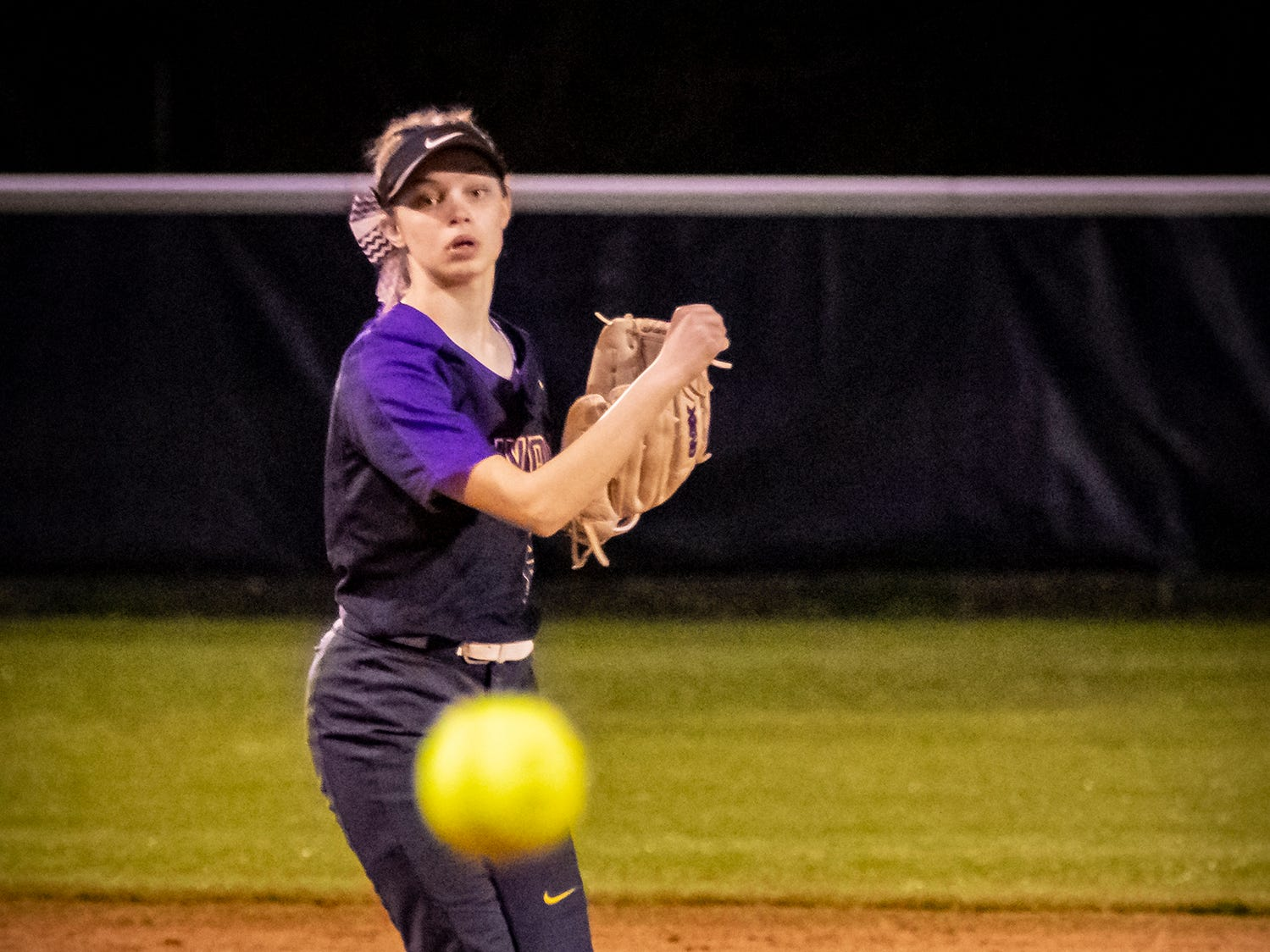 Smyrna's Ashlynn Dimmick throws a runner out at first during Monday's game at Siegel.