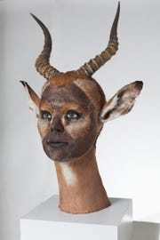 "Kate Clark (American), ""The Answer to Your Prayers,"" 2013, antelope hide, antlers, foam, clay, pins, thread, rubber eyes, wood, paint.  Collection of Laura Lee Brown and Steve Wilson, 21c Museum Hotels."