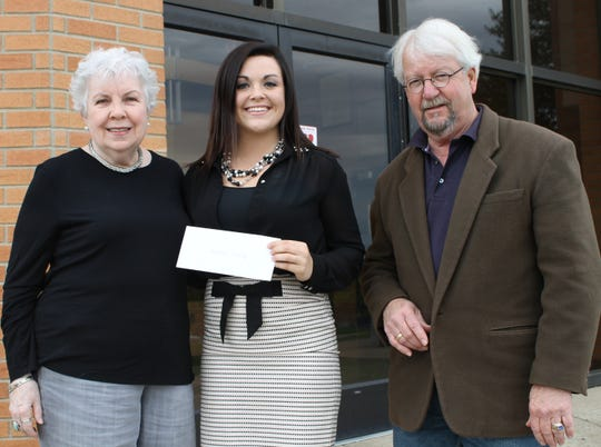 Emma Hall, left and John Reynolds, right, present Sydney Murphy with a scholarship sponsored by Peggy's Support Group in 2013. This support group was started by the late Peggy Reynolds, John's wife, to help anyone who needs emotional and or financial support going through cancer diagnosis and treatment.