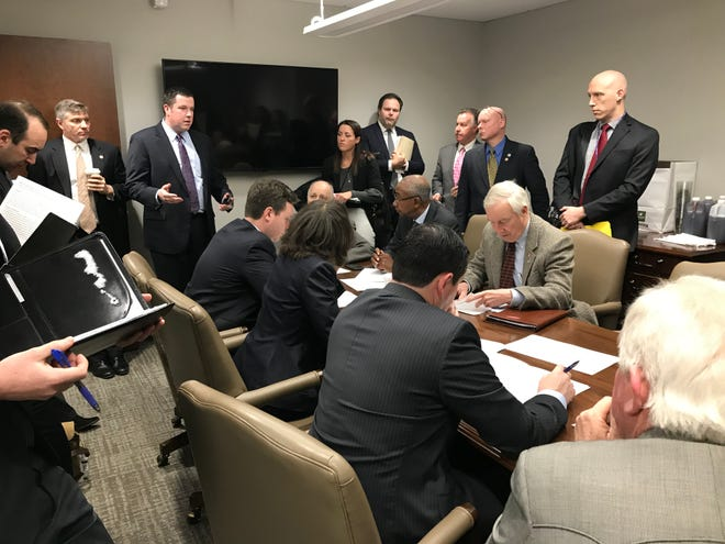 Rep. Timothy Hill (center left), R-Blountville, explains one of his bills during a pre-meeting gathering of the House Public Service and Employees Subcommittee on March 5, 2019.