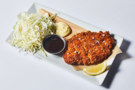 Tonkatsu: breaded pork cutlet with shredded cabbage, kewpie mayo, lemon and bull-dog sauce at Bar Otaku.