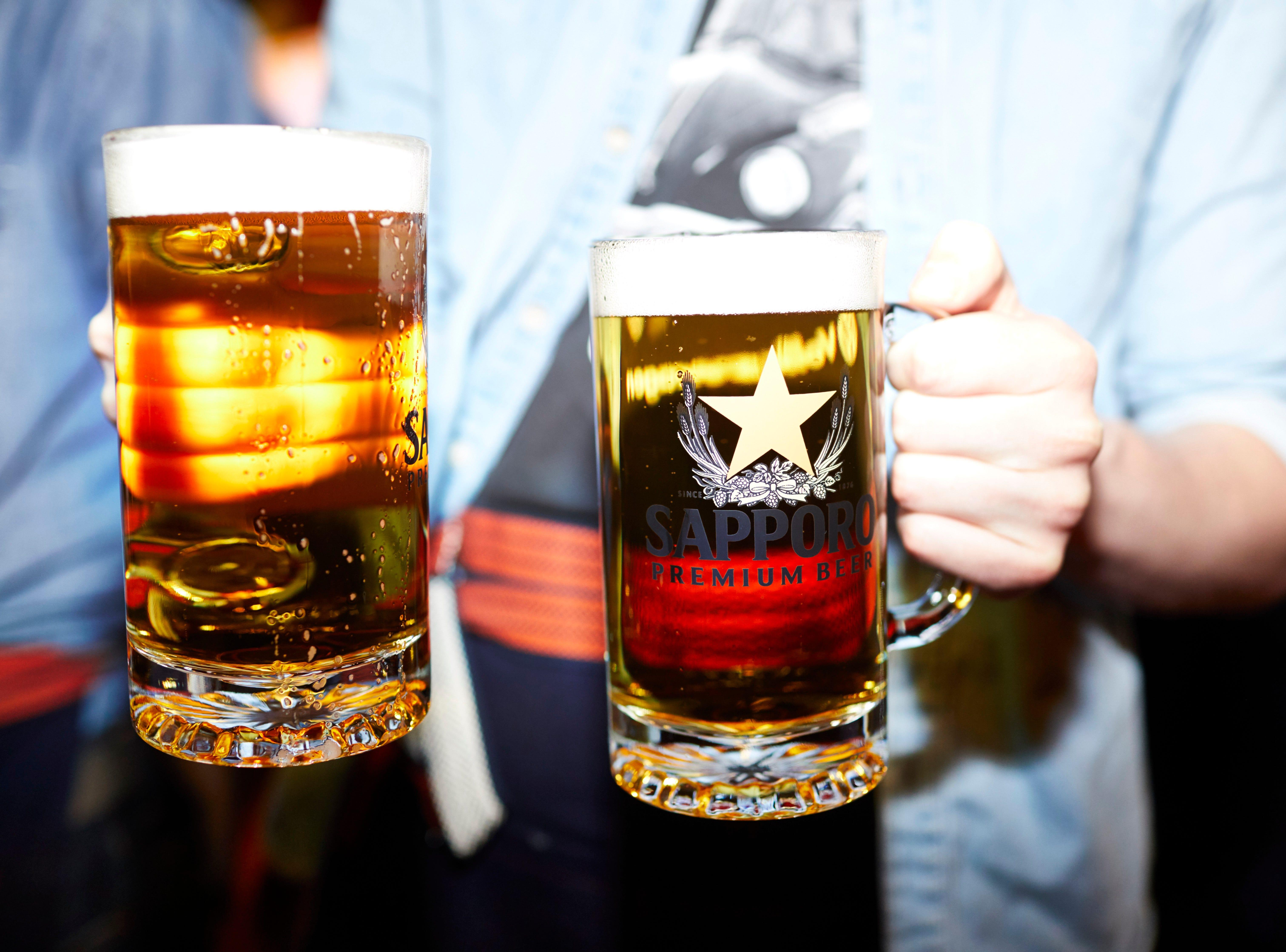 Mugs of Sapporo beer at Bar Otaku.