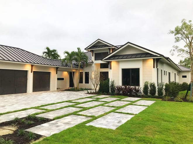 KTS Homes' Newport floor plan was chosen by a client and built on a large homesite in Naples Club Estates.