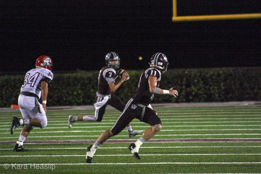 First Baptist Academy quarterback Brady Dean rolls out for a pass during a 2018 game. Dean has transferred to St. Thomas Aquinas in Fort Lauderdale.