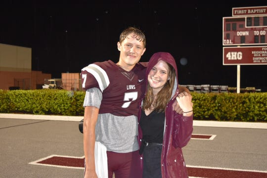 Brady Dean (left) stands with his sister, Grace, after a First Baptist Academy football game in 2018. Four Dean siblings have attended FBA since pre-K, but Brady Dean has transferred to play quarterback at St. Thomas Aquinas in Fort Lauderdale.