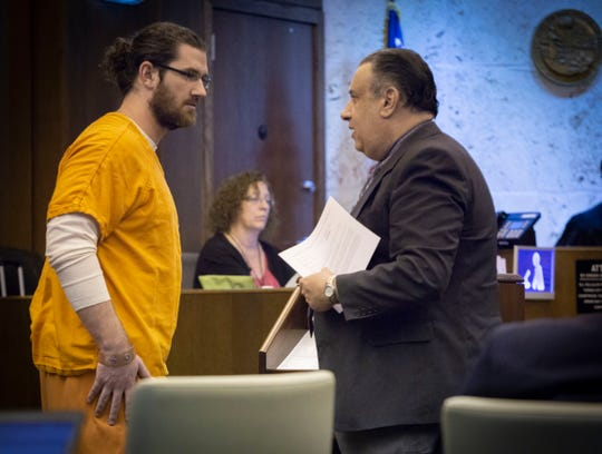 Brock Smith, the former Naples High School teacher accused of sex with a student, listens to his attorney, public defender Shawn Nagle, before he  pleads no contest to some charges in front of Collier Circuit Judge Ramiro Mañalich on Tuesday, March 12, 2019. A jury trial for his other charges is pending.