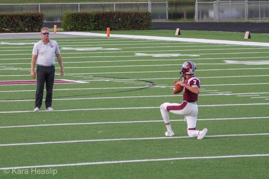 Quarterback Brady Dean, throwing with his dad and First Baptist Academy assistant coach Terry Dean during a 2018 practice, has transferred from FBA to St. Thomas Aquinas in Fort Lauderdale.