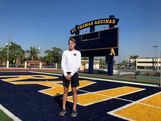 Former First Baptist Academy quarterback Brady Dean stands on the field at his new school. After starting as a sophomore in 2018, Dean has transferred to St. Thomas Aquinas in Fort Lauderdale.