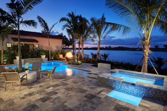 Benitas model offers lakefront views, an outdoor kitchen with seating and a custom pool.