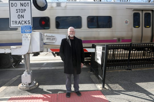 Thomas Dougan, NJ Transit Conductor who was injured in the 2016 Hoboken Terminal crash and forced into early retirement, poses near train tracks in Fair Lawn.  Tuesday, March 12, 2019