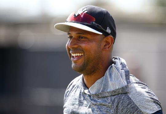 New York Yankees center fielder Aaron Hicks (31) smiles at a comment from New York Yankees right fielder Aaron Judge (not pictured) during spring training workouts at George M. Steinbrenner Field.