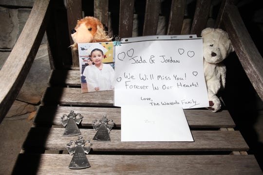 Notes, stuffed animals and angels sit on a chair outside the home of Zoey Mendoza-Birth in Pompton Lakes, where she lived with her husband and two children. According  to police, Kurtis Birth, 38, of Pompton Lakes shot and killed his two young children with a rifle at before committing suicide in 2010.