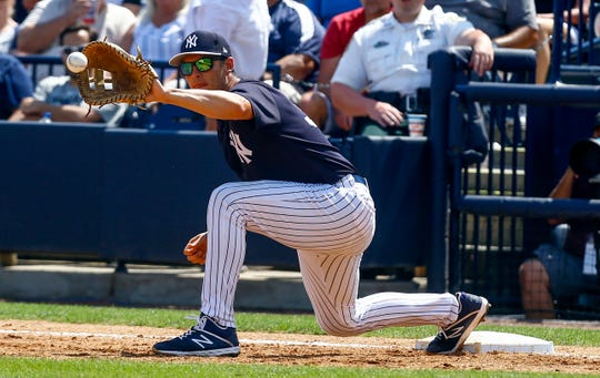 New York Yankees first baseman Greg Bird (33) catches a throw to retire Pittsburgh Pirates outfielder Melky Cabrera (not pictured) during the third inning at George M. Steinbrenner Field.