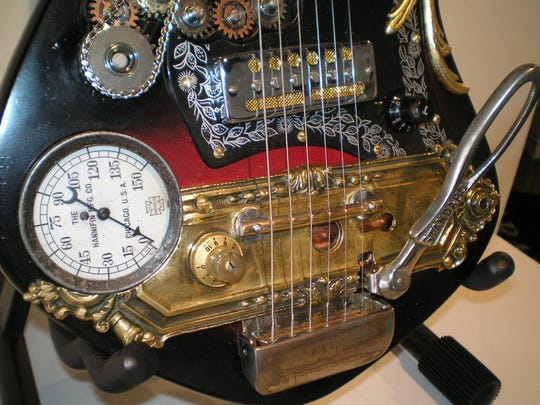 "The Steampunk aesthetic. A ""Steampunk"" instrument  by Steve Brook,  a 1964 Norma Guitar with parts 20 to 100 years old. This guitar made its debut at the World Steam Expo in Dearborn, Michigan."