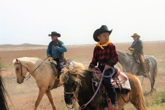 """Jose Luis Sanchez, 7,  rides his pony, """"Coqueta"""" during 2019 Cabalgata."""