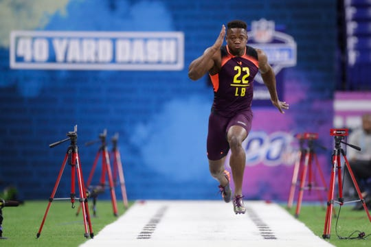 New Mexico State linebacker Terrill Hanks runs the 40-yard dash at the NFL football scouting combine in Indianapolis, Sunday, March 3, 2019. (AP Photo/Michael Conroy)