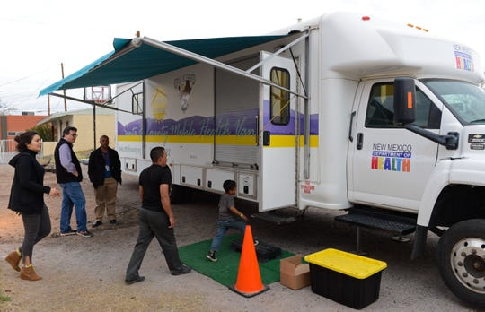 Migrants enter a mobile medical van provided by the New Mexico Department of Health outside El Calvario United Methodist Church on Monday, March 11, 2019.