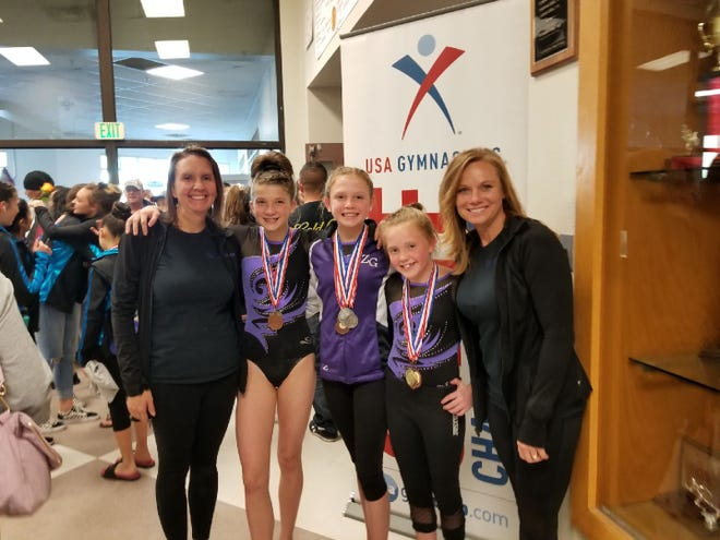 From left to right, Coach Leslie Anderson Kelley, gymnasts Ellie Scholljegerdes, Maija Noopila, Mila Noopila and Coach Bridget Scholljegerdes.