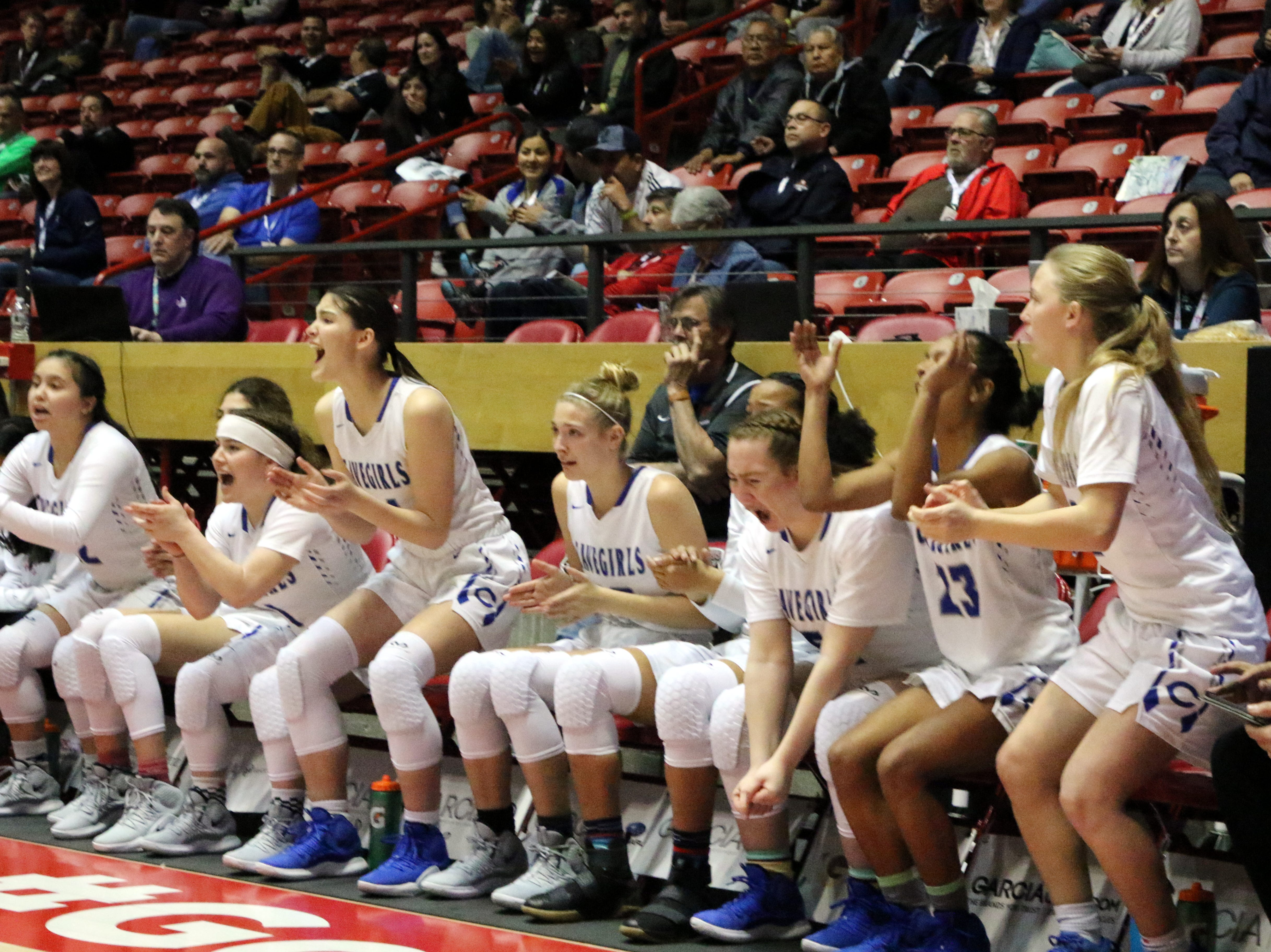 Carlsbad's bench applauds after a Carsyn Boswell drains all three of her free throws in the final minute of regulation against Volcano Vista in Tuesday's Class 5A quarterfinals game at The Pit. Carlsbad won, 41-39 in overtime.