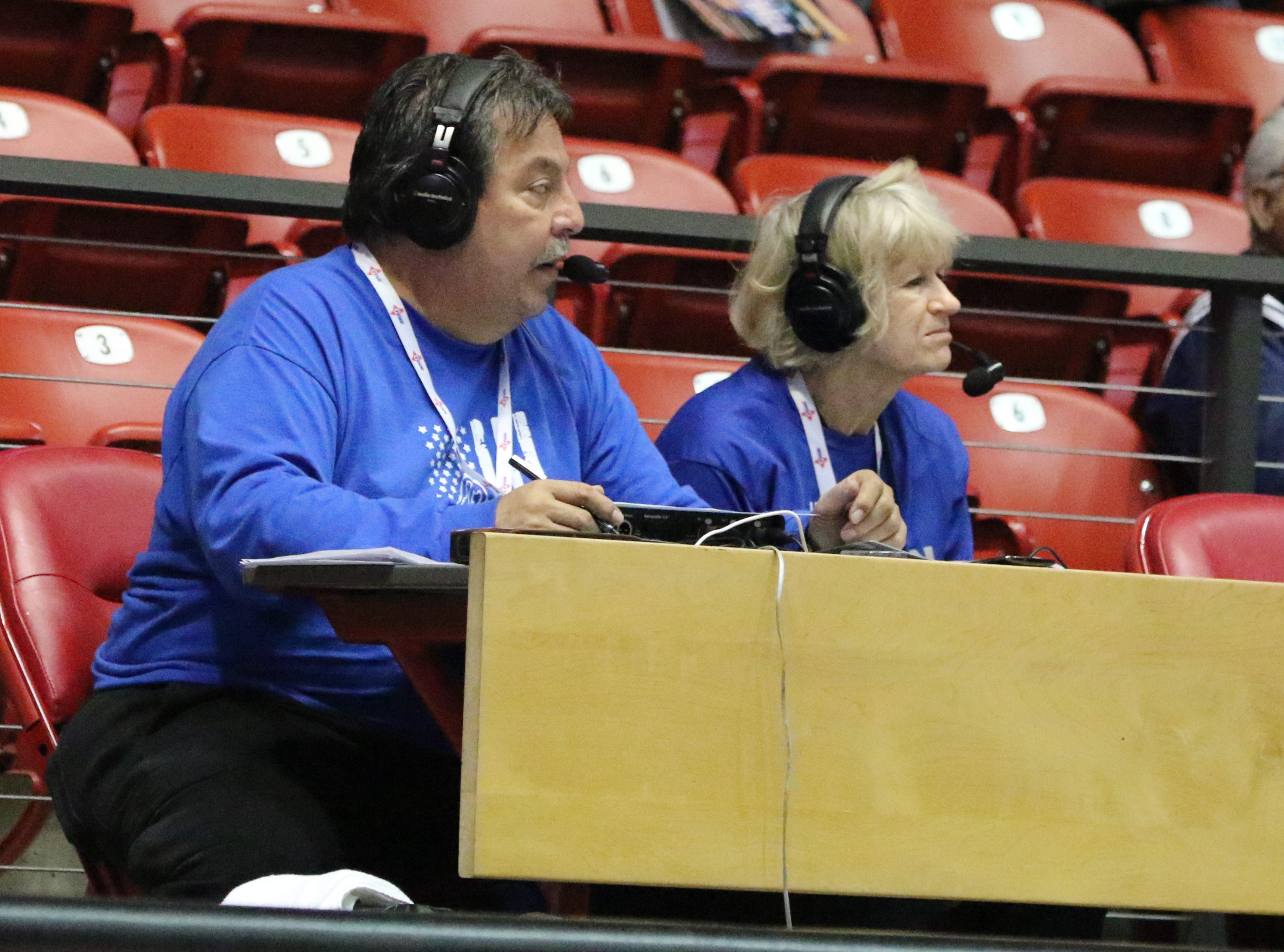 Jerry Flores and Carole Cristiano do play-by-play during Carlsbad's game against Volcano Vista in Tuesday's Class 5A quarterfinals game at The Pit. Carlsbad won, 41-39 in overtime.