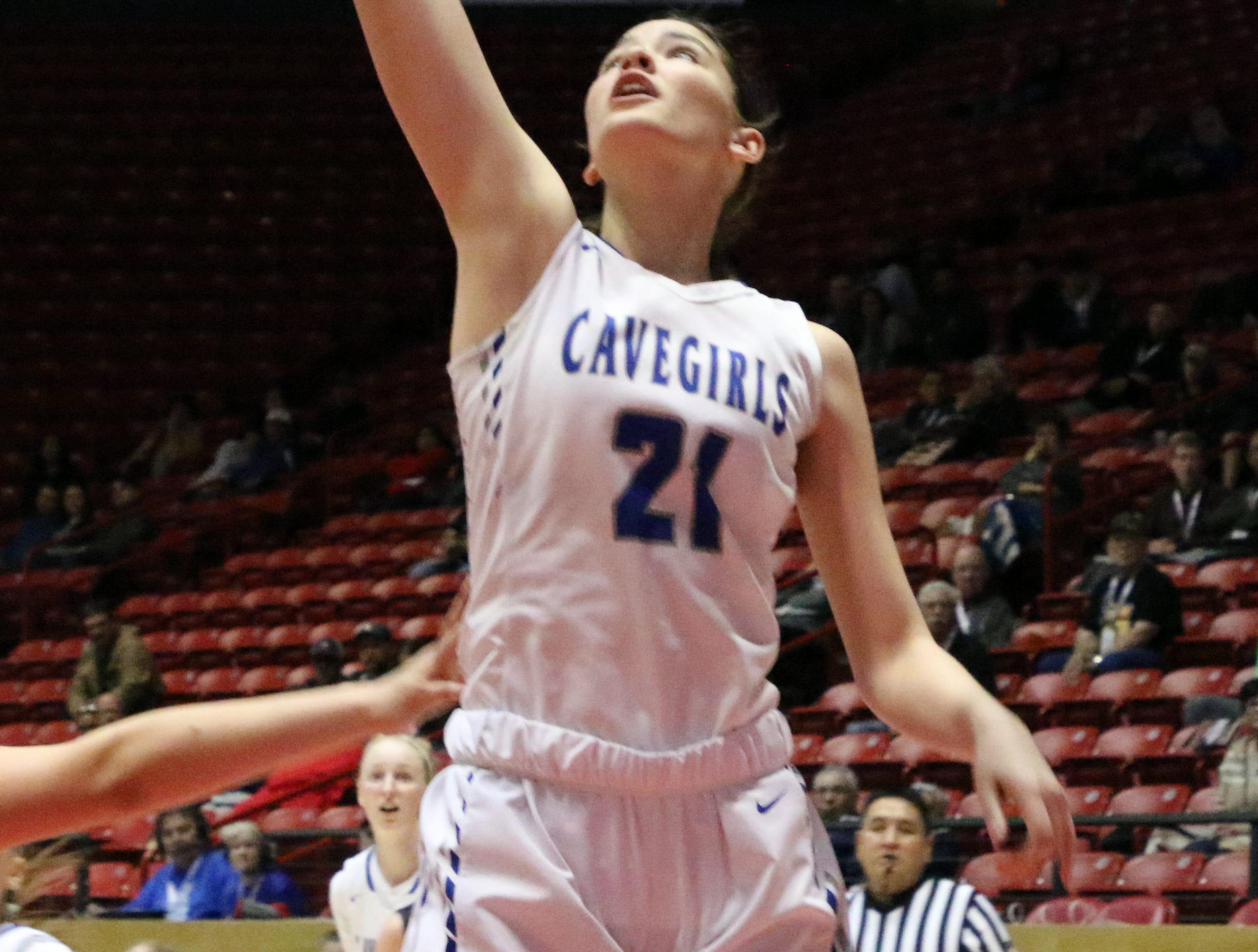 Morgan Boatwright watches her jump shot go in against Volcano Vista.