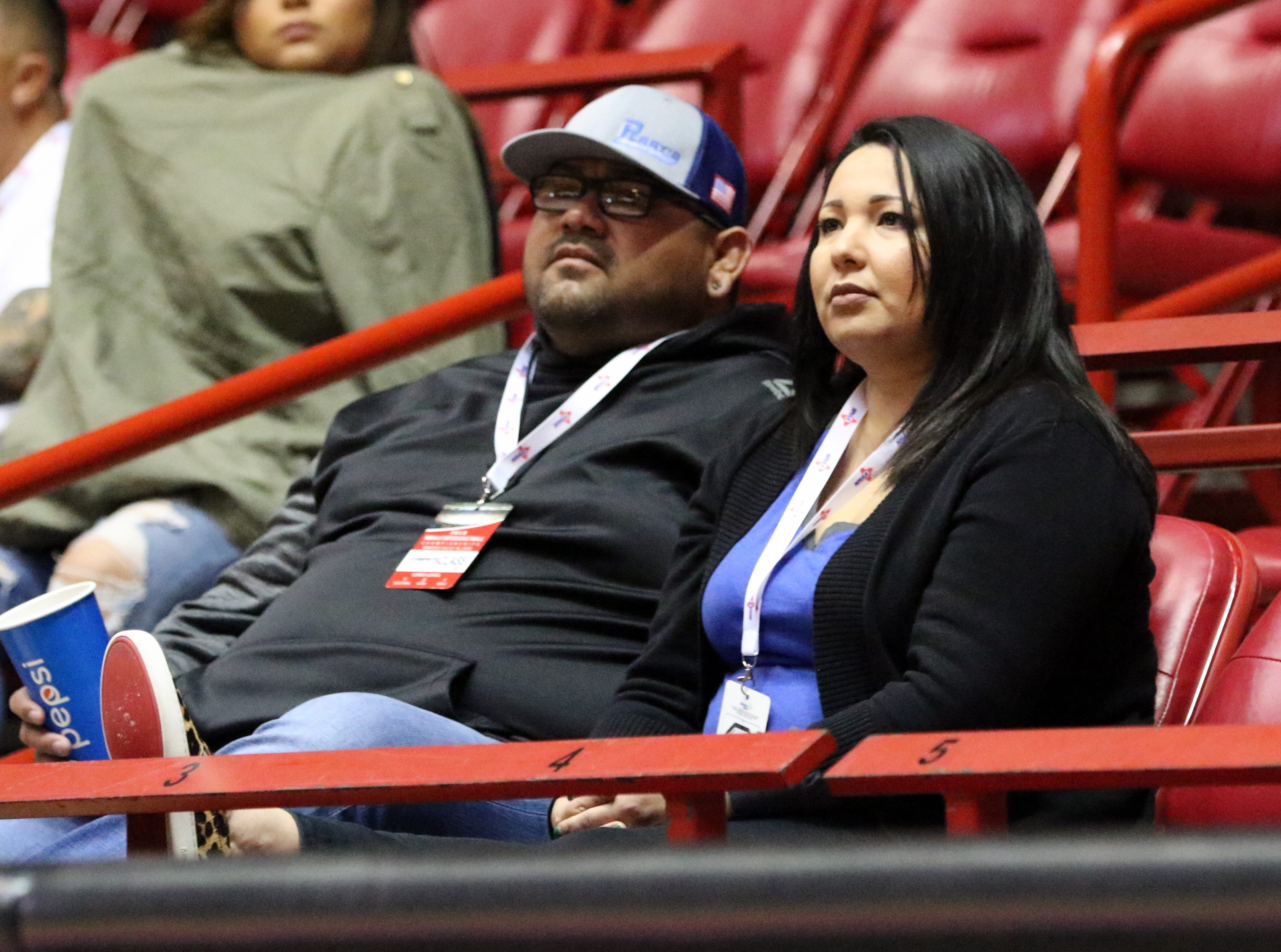 A couple of Carlsbad fans watch the Cavegirls play Volcano Vista in Tuesday's Class 5A quarterfinals game at The Pit. Carlsbad won, 41-39 in overtime.