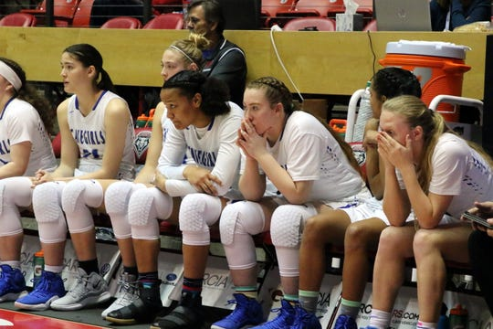 Carlsbad's bench can't watch Carsyn Boswell attempt her three free throws late in the fourth quarter. Boswell would make all three.