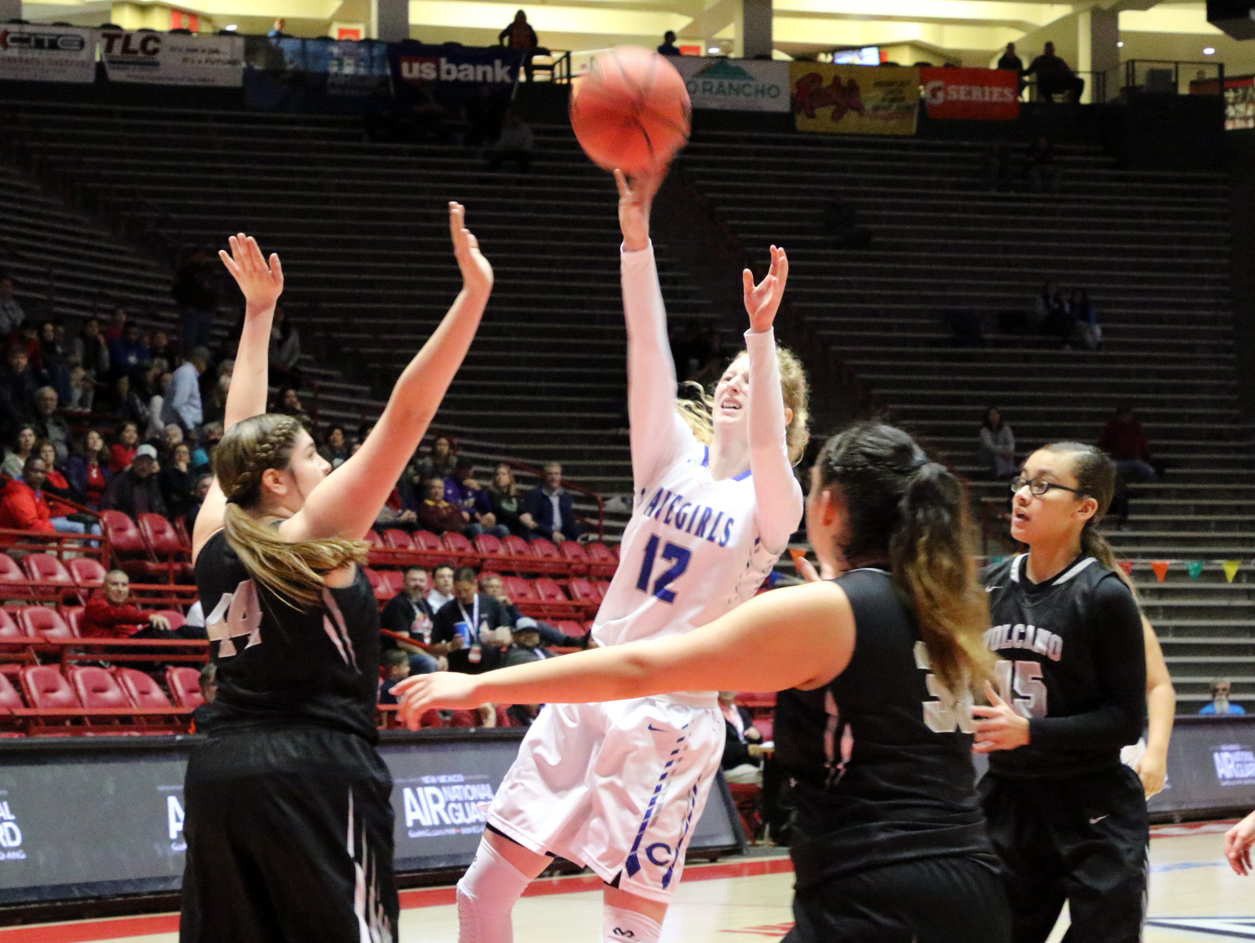 Carlsbad's Carsyn Bowell makes the game-winning shot with less than 30 seconds left in overtime. Boswell scored 12 points to lead the Cavegirls over Volcano Vista, 41-39.
