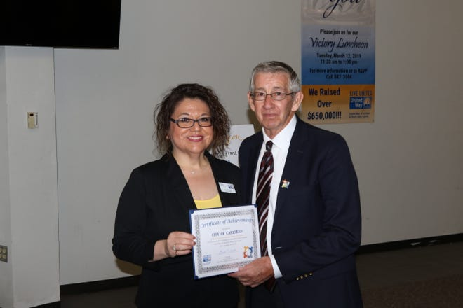 United Way of Carlsbad and South Eddy County Executive Director Linda Dodd (left) and Carlsbad Mayor Dale Janway during the March 12 Victory Luncheon.