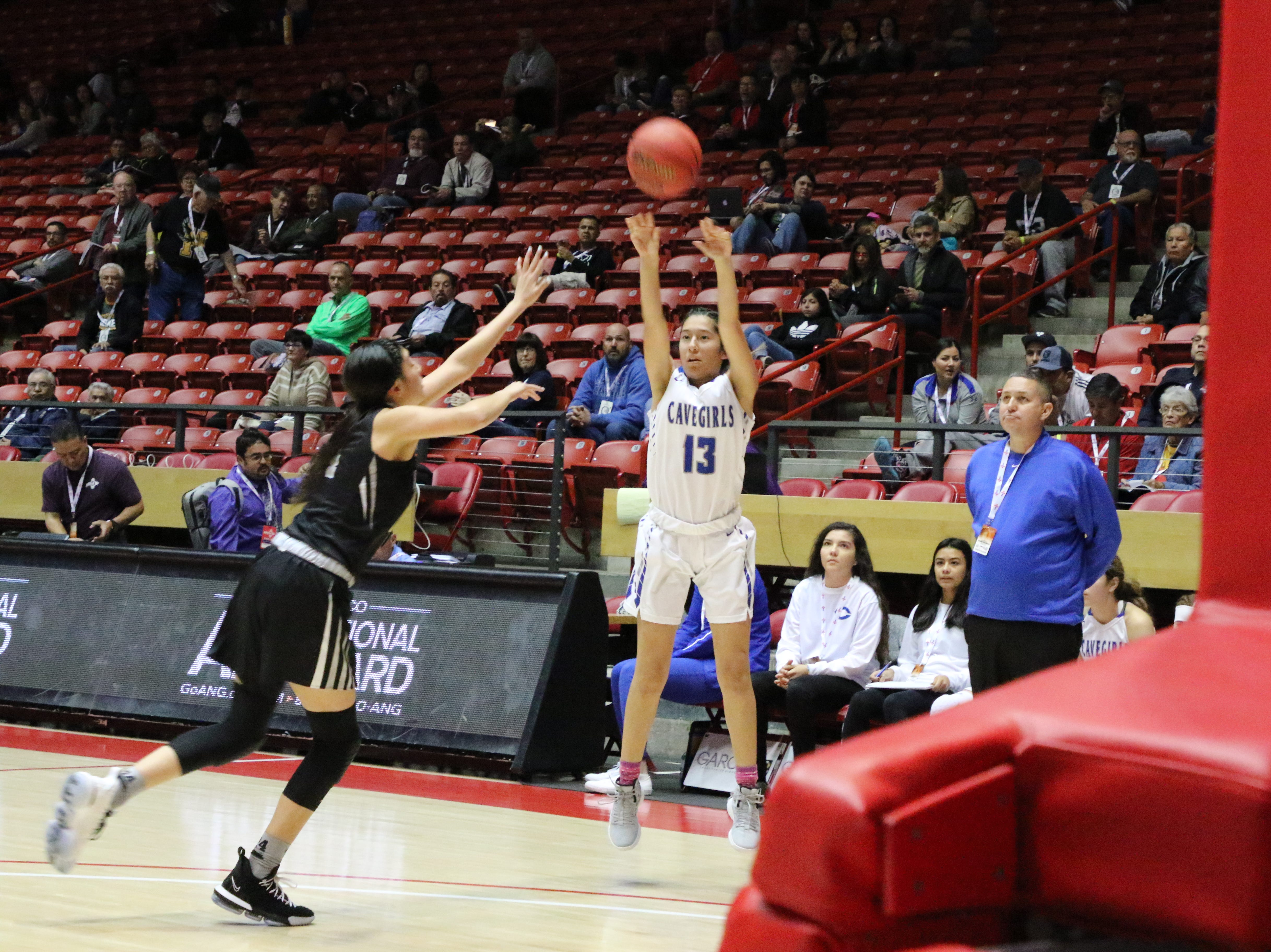Tori Flores takes a 3-point shot against. Volcano Vista. Flores finished with nine points, all came off made 3's.