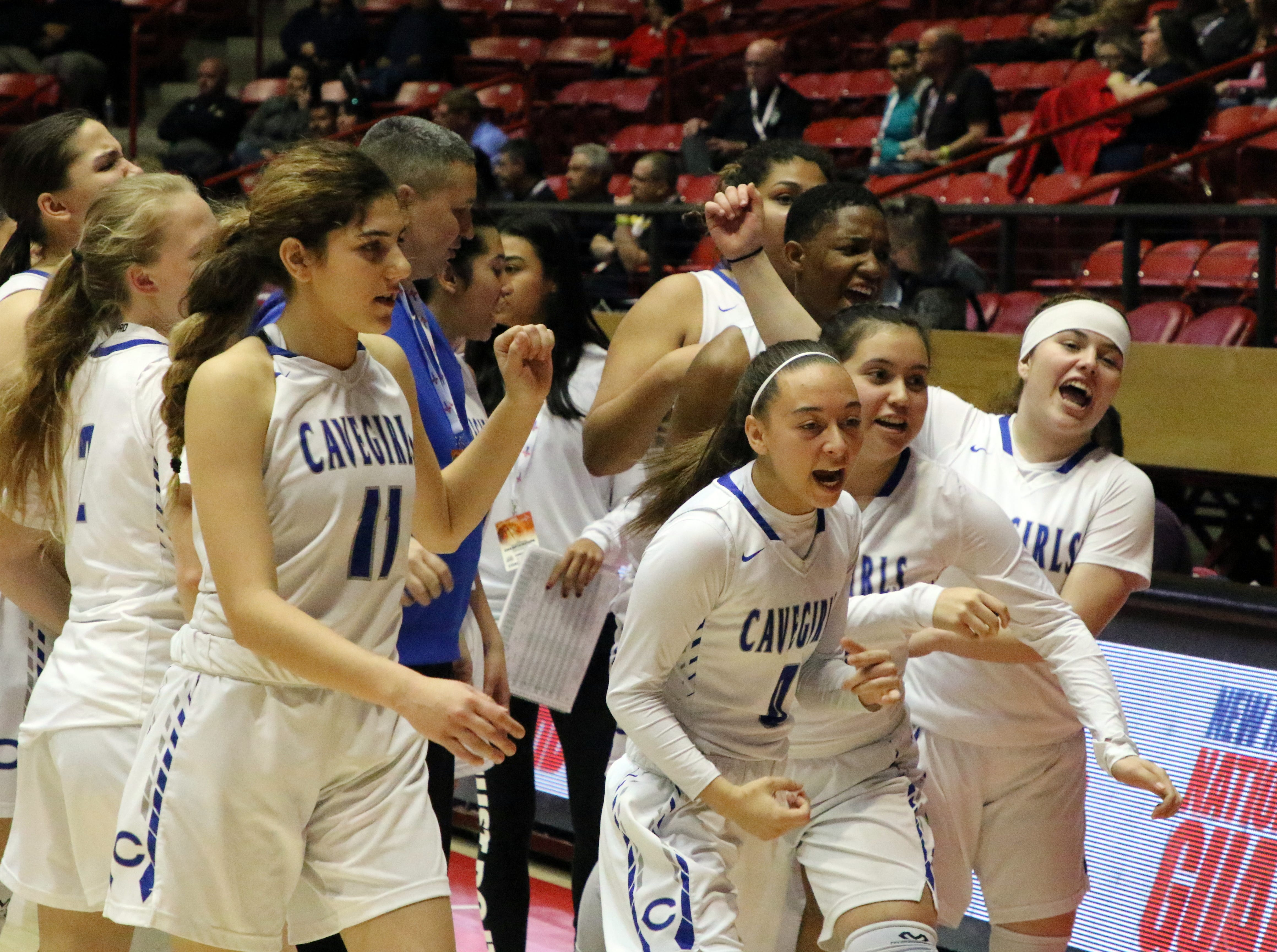 The Carlsbad Cavegirls run off the court celebrating after their 41-39 overtime win on Tuesday morning at The Pit. Carlsbad will play Thursday at 9:45 a.m.