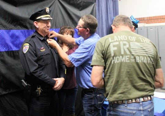 Capt. Richard Denton gets pinned on at an Alamogordo Police Department promotion ceremony March 8.