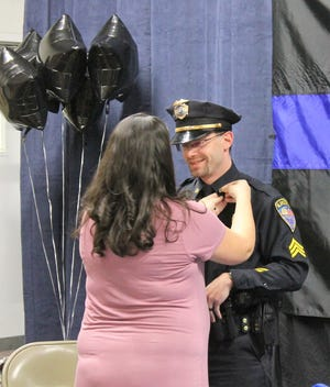 Sgt. Justin Mitchell gets pinned on at an Alamogordo Police Department promotion ceremony March 8.