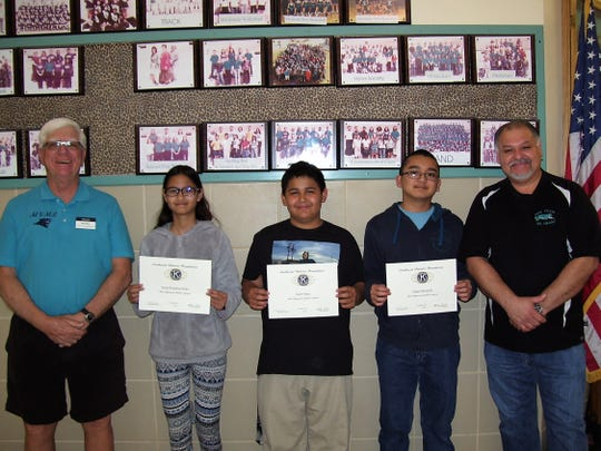 The February Most Improved students at Mountain View Middle School are from left to right: Jenna Stoke, Juan Onate and Aidan Mendiola. Also pictured is Ned Kline of Alamogordo Kiwanis Club and Principal Moises Cardiel.