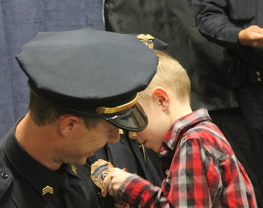 Lt. Ryan Glidden gets pinned on during an Alamogordo Police Department promotion ceremony March 8.