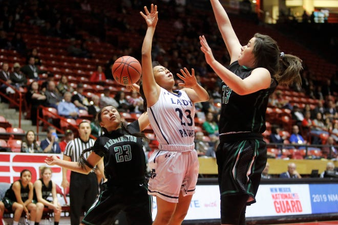 Farmington's Kiiyani Anitielu (23) comes up from behind and blocks a shot by during Piedra Vista's Hallie Blackie during Tuesday's 5A state quarterfinals game at Dreamstyle Arena in Albuquerque.