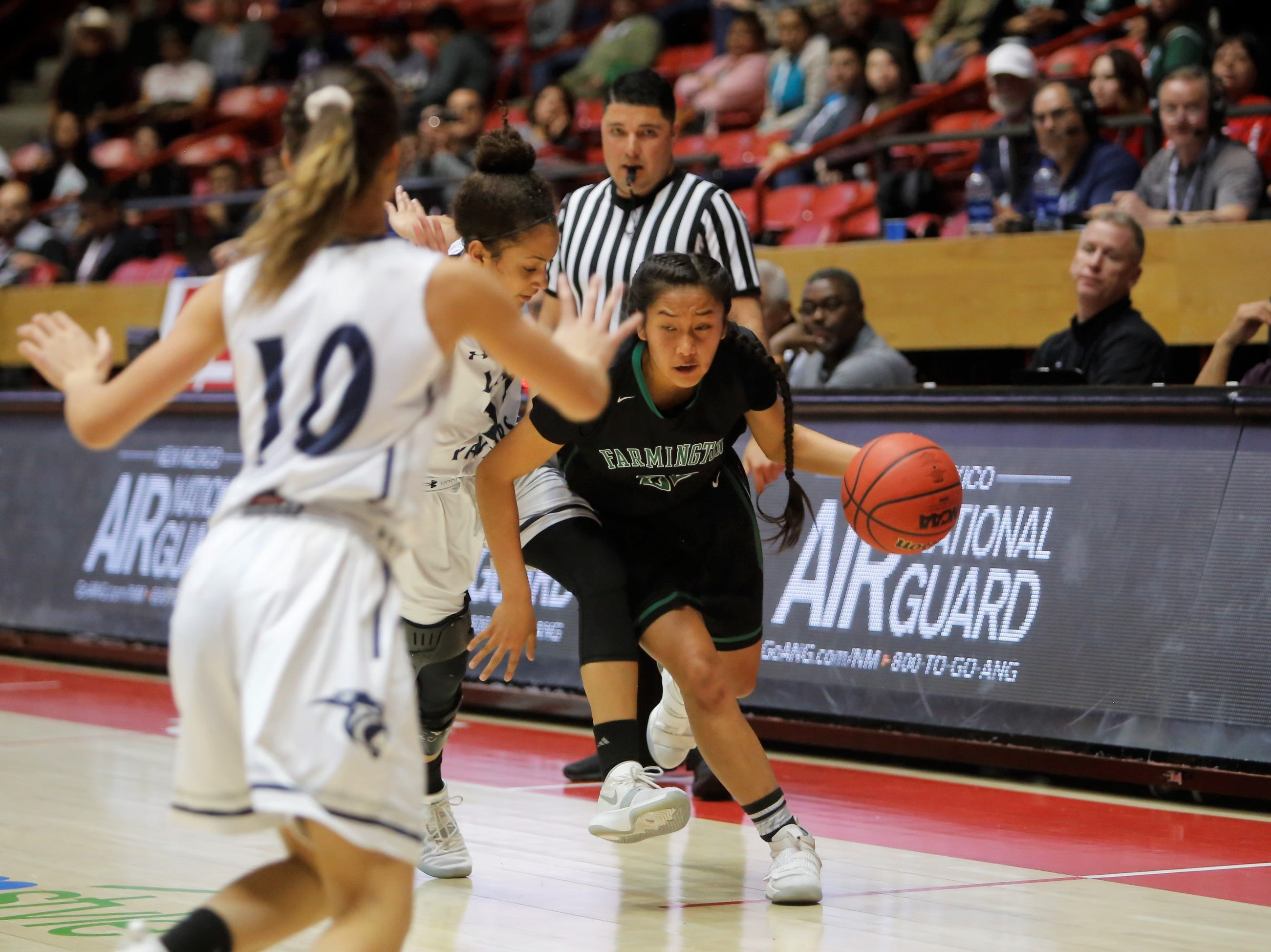 Farmington's Kiiyani Anitielu drives along the the far left baseline against Piedra Vista during Tuesday's 5A state quarterfinals game at Dreamstyle Arena in Albuquerque.