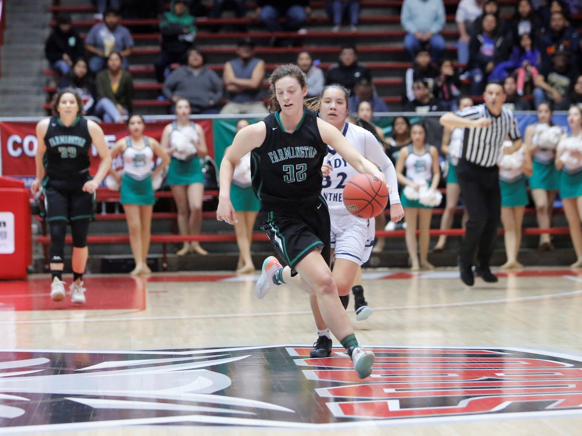 Farmington's Jordan Vasquez drives down the floor on the fast break against Piedra Vista during Tuesday's 4A state quarterfinals game at Dreamstyle Arena in Albuquerque.