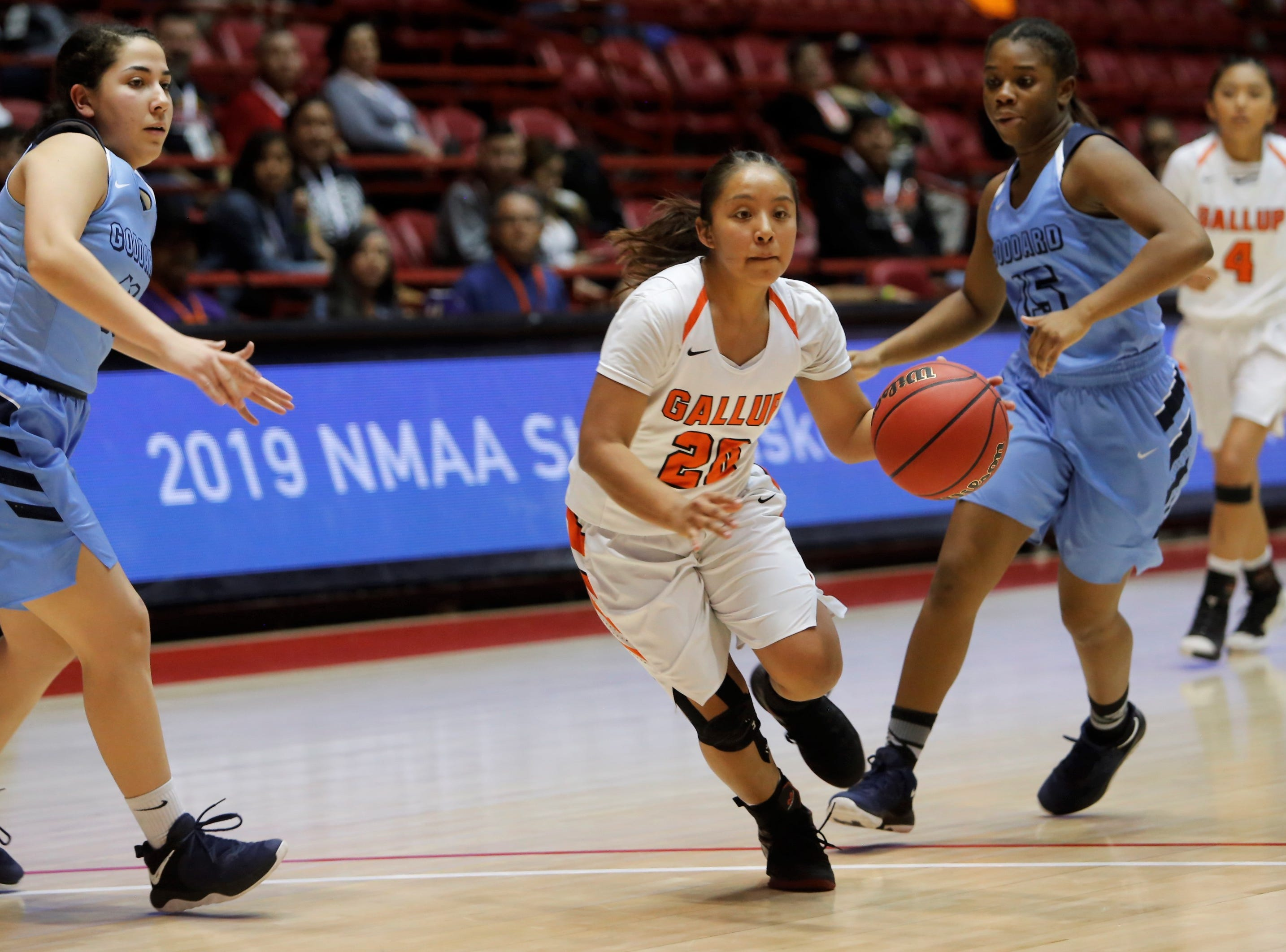 Gallup's Kamryn Yazzie drives toward the basket against Goddard during Tuesday's 4A state quarterfinals game at Dreamstyle Arena in Albuquerque.